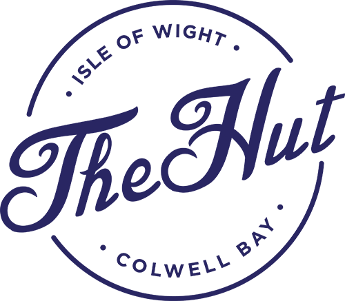 Hut House Logo: The Easy-Going Beach Restaurant